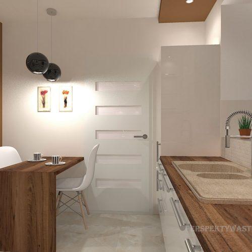 projekt-kuchni-salonu-projektowanie-wnętrz-lublin-perspektywa-studio-kuchnia-nowoczesna-białe-fronty-lakierowane-drewno-piekarnik-w-wysokiej-zabudowie-salon-łupek-kominek-narożny-Tulipan-10